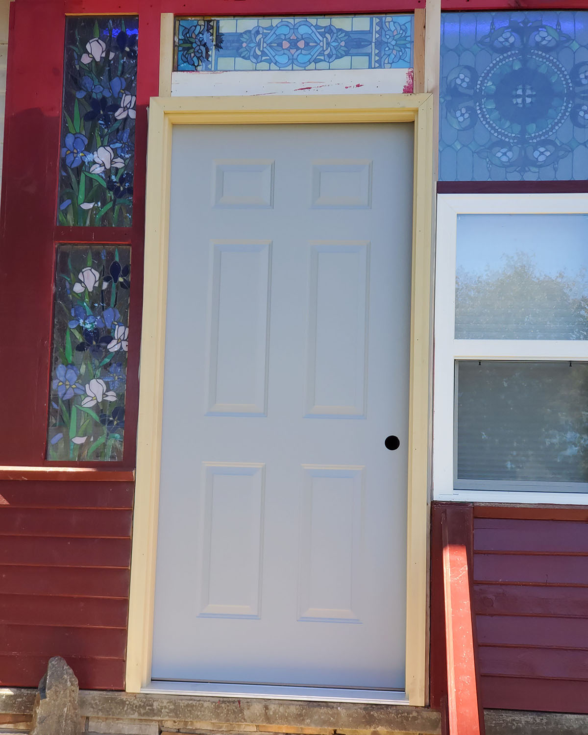 A door and storm door to enclose the porch.