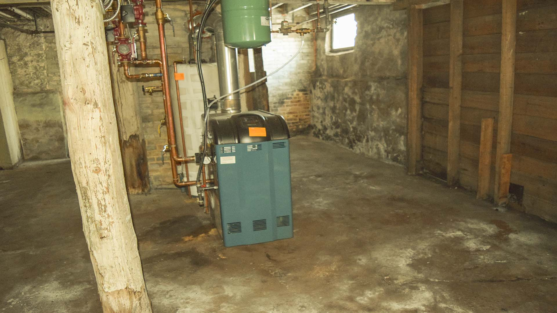 Here is a new furnace, it looks like it didn't get used because there were leaky radiators throughout the house to fix.
