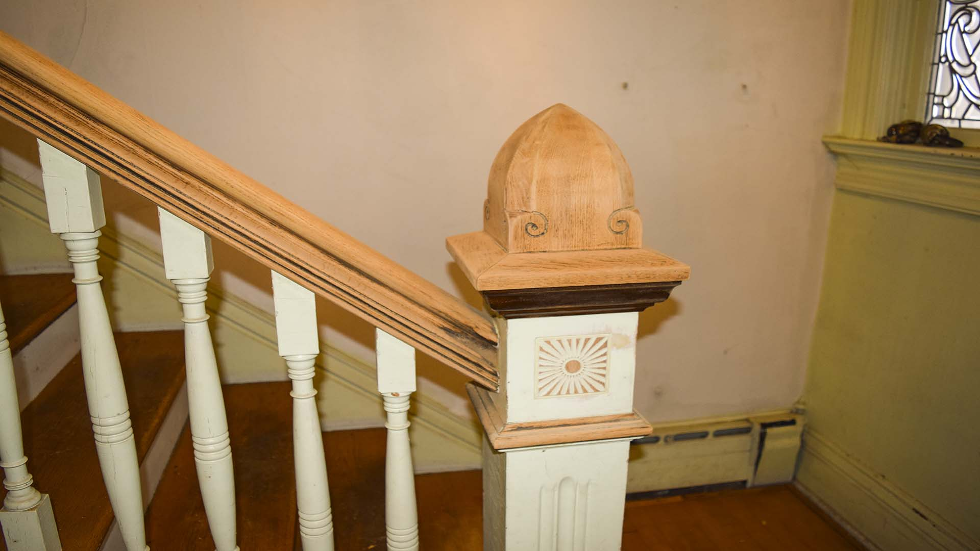 Now we are getting all the old finish off the banister.